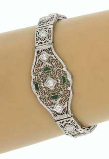 this is a vintage art deco 14k gold diamonds and emeralds ladies