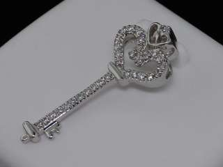 LADIES WHITE GOLD .1C DIAMOND HEART KEY CHARM PENDANT